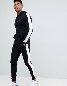 1d9e459c09d9 Черные спортивные суперузкие брюки и худи с полосками по бокам ASOS DESIGN  - Черный