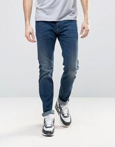 Темные зауженные эластичные джинсы Diesel Thommer 84BU - Синий
