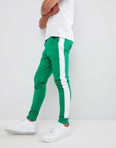 Зеленые джоггеры скинни с полосками по бокам ASOS DESIGN - Зеленый