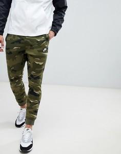 Зеленые джоггеры с камуфляжным принтом Nike AR1306-325 - Зеленый