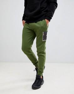 Джоггеры скинни с камуфляжными вставками ASOS DESIGN - Зеленый