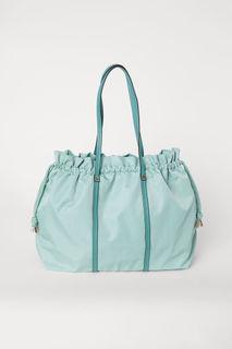 Нейлоновая дорожная сумка H&M