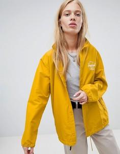 Желтая спортивная куртка с логотипом на спине Herschel - Желтый
