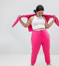 Розовые спортивные брюки с логотипом-галочкой Nike Plus - Розовый