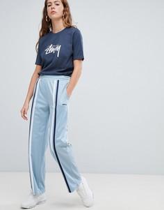 Спортивные брюки с широкими штанинами и полосками Stussy - Синий