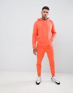 Спортивный костюм из джоггеров скинни и худи оранжевого цвета ASOS DESIGN - Оранжевый