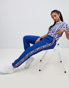 Спортивные штаны в стиле ретро с отделкой кантом с логотипом Champion - Темно-синий