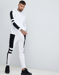 Монохромный спортивный костюм из худи и супероблегающих джоггеров со вставками ASOS DESIGN - Белый