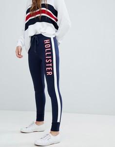 Спортивные штаны скинни с логотипом Hollister - Темно-синий