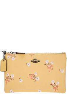 Желтый клатч с цветочным принтом Coach