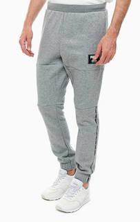 Серые хлопковые брюки джоггеры с принтом Puma