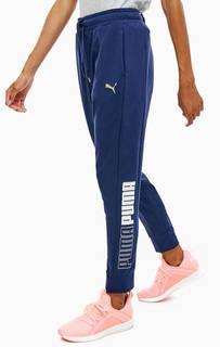 Синие хлопковые брюки джоггеры с принтом Puma