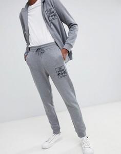 Серые джоггеры зауженного кроя с логотипом Love Moschino - Серый