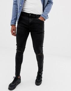 Черные джинсы скинни с эффектом кислотной стирки и рваной отделкой Bershka - Черный
