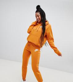Оранжевые спортивные штаны с логотипом Nike Rally - Оранжевый
