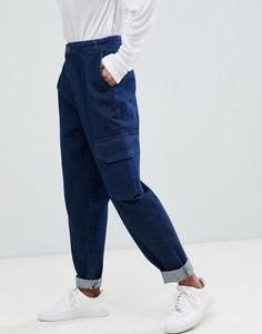 Суженные книзу джинсы с карманами в стиле милитари ASOS DESIGN - Синий
