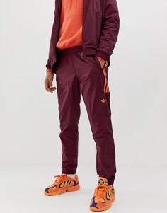 Красные спортивные брюки adidas Originals - Красный