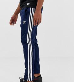Спортивные штаны с кнопками adidas Originals - Темно-синий