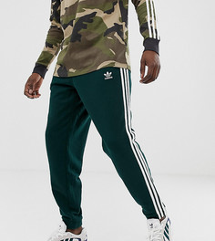 Спортивные брюки с тремя полосками adidas Originals - Зеленый