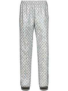 Gucci блестящие спортивные брюки с узором GG