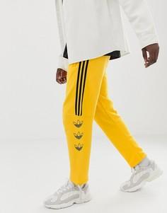 Желтые джоггеры в полоску с логотипом-трилистником adidas Originals DV3149 - Желтый
