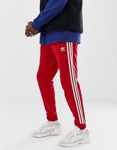 Красные джоггеры скинни с 3 полосками и манжетами adidas Originals DV1534 - Красный