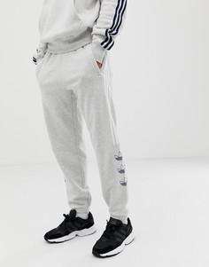 Серые джоггеры с полосками adidas Originals DV3150 - Серый