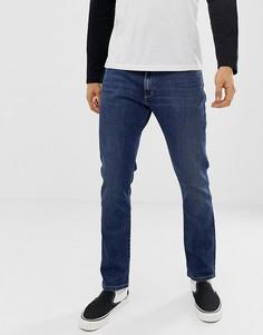 Суженные книзу узкие джинсы цвета индиго Wrangler larston - Синий