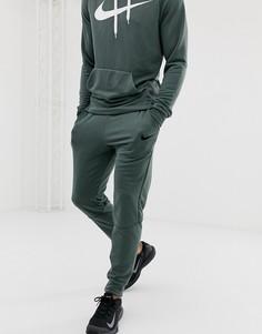 Зеленые суженные книзу брюки Nike Training - Зеленый