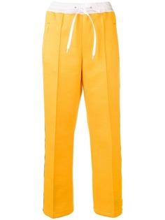 Miu Miu спортивные брюки с полосками с логотипами