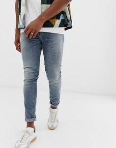 Выбеленные зауженные джинсы со вставками United Colors Of Benetton - Синий