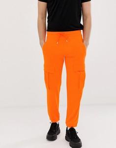Оранжевые джоггеры карго ASOS DESIGN - Оранжевый