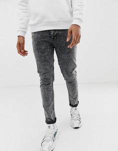 Черные джинсы скинни с эффектом кислотной стирки ASOS DESIGN - Черный