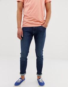 Темные зауженные джинсы Wrangler Bryson - Синий
