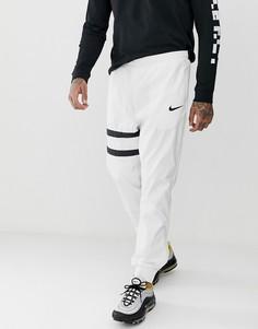 Белые спортивные брюки Nike FC - Белый