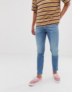 Светлые зауженные джинсы Wrangler Bryson - Синий
