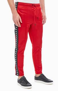 Спортивные красные брюки с лампасами Kappa