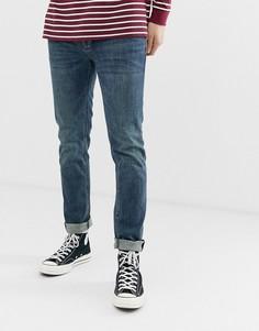 Темно-выбеленные джинсы скинни ASOS DESIGN - Синий