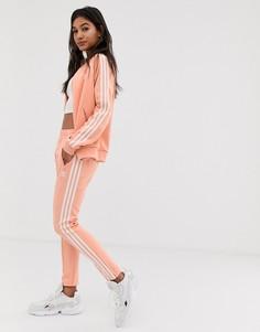 Розовые узкие брюки с тремя полосками adidas Originals adicolor - Розовый