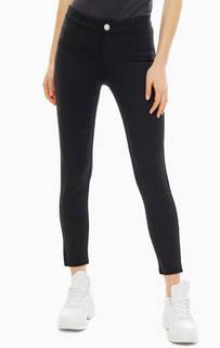 Черные трикотажные брюки с накладными карманами Guess