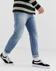 32e2d752688 Выбеленные синие суженные книзу джинсы с потертостями ASOS DESIGN - Синий