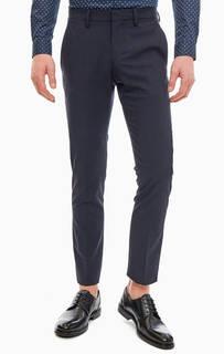 Зауженные синие брюки в классическом стиле Lacoste