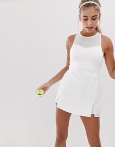 e706dcefe40 Белое теннисное платье с высоким воротом и плиссированной юбкой South Beach  - Белый