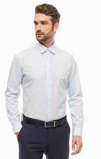 Рубашка белого цвета с мелким принтом черного и синего цветов. Выполнена из плотного хлопка в повседневном стиле. Приталенный крой, длинные рукава, застегивается на пуговицы. Selected