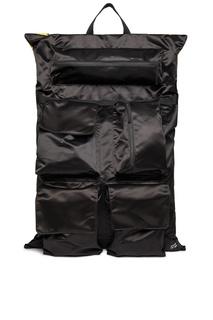 Черный рюкзак с накладными карманами Eastpak
