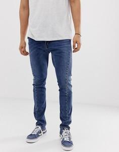 Узкие выбеленные джинсы с асимметричным швом Levis Engineered - Синий