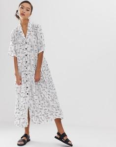 Черное платье-рубашка миди в горошек с карманами Monki - Белый