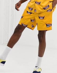 Желтые шорты с принтом губ Obey - Желтый