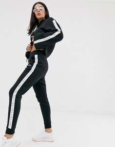 Черные спортивные штаны с завышенной талией и фирменной лентой Reebok - Черный