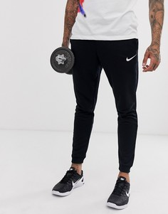 Черные суженные книзу брюки из флиса Nike Training - Черный